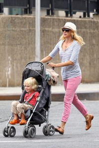Naomi Watts, wearing a striped top and pink jeans, spends quality time with her son Sasha while out and about in Soho